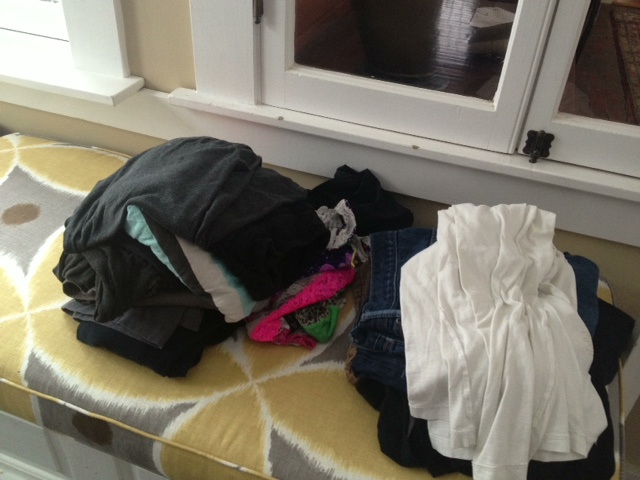 This is how that same beautiful window seat really looks usually.  Um, that's laundry.
